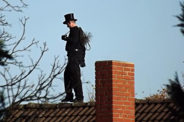 Kominík na střeše